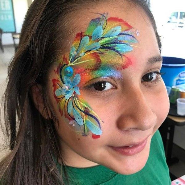 Colorful Tiger Face paint design. Flower Eye Design