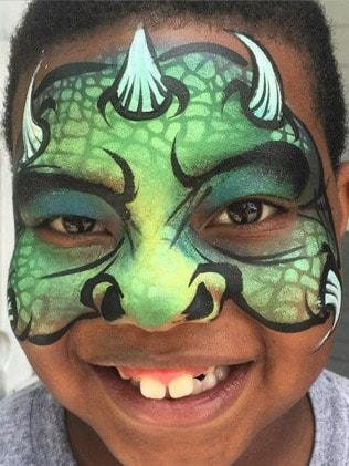 monster face paint design on young boy