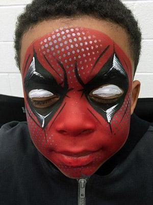 deadpool face paint design on young boy