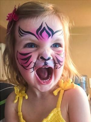 tiger face paint on young girl